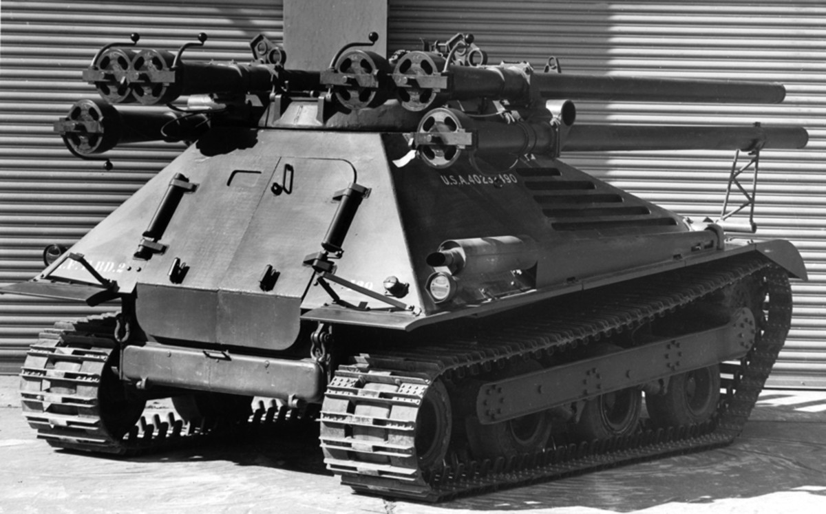 While this vehicle looks like a M50 Ontos, this vehicle is actually a T165, a development model. The suspension and rear doors were different, but the general layout remained the same in the production model.