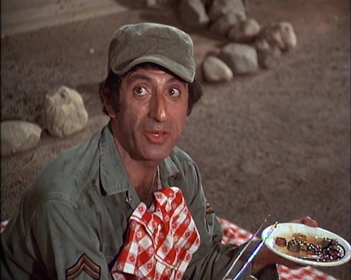 Jamie Farr as Maxwell Klinger in the television series, MASH, eating oiled bolts and nuts.