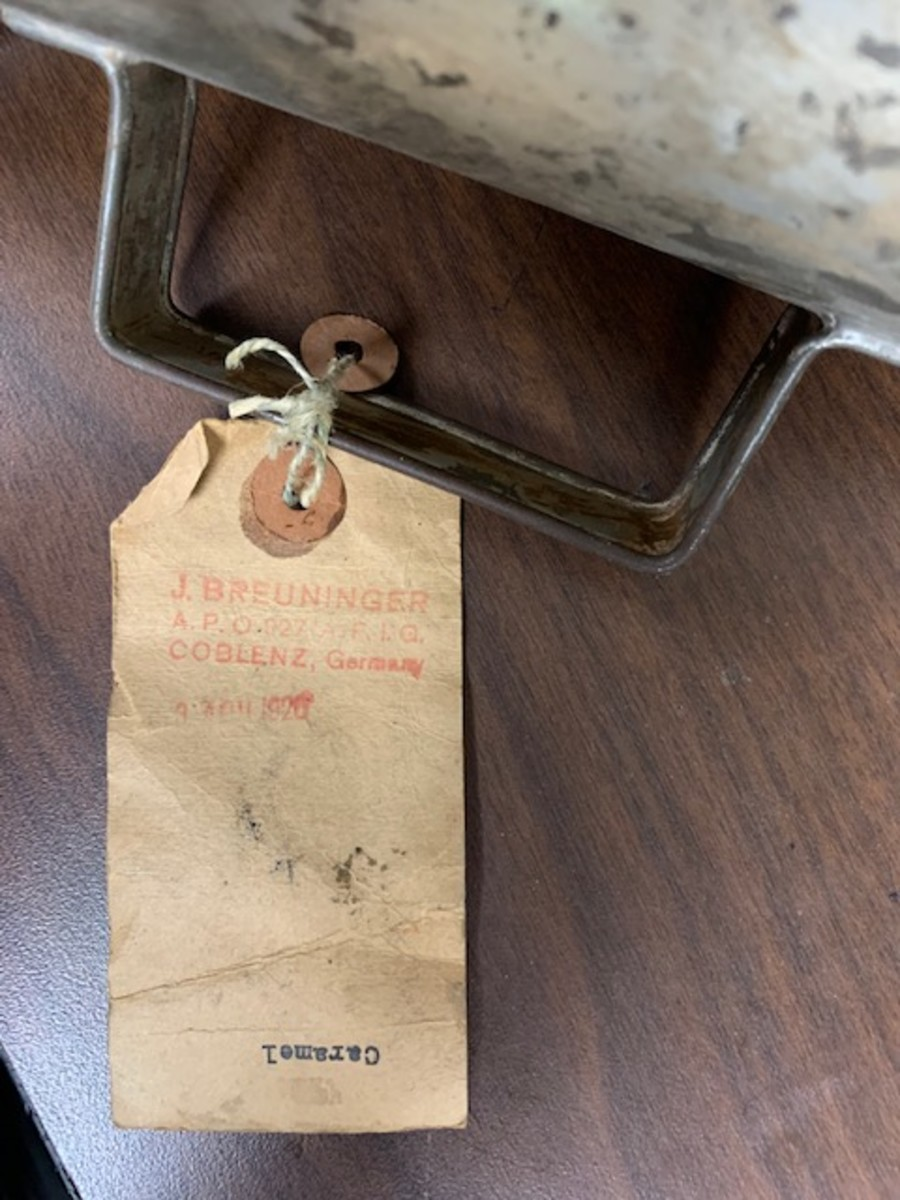 Back of tag with stamped addressed in red ink. Dated April 1920.