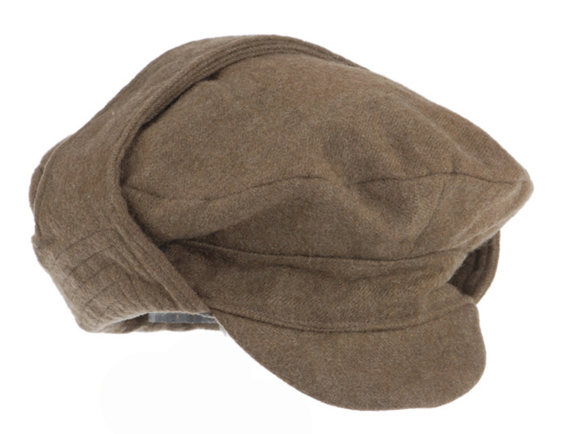 """The """"Cap, Winter, Service Dress"""" was a soft cap featuring heavy padding, a flexible visor and, most importantly, a neck flap that provided extra warmth."""