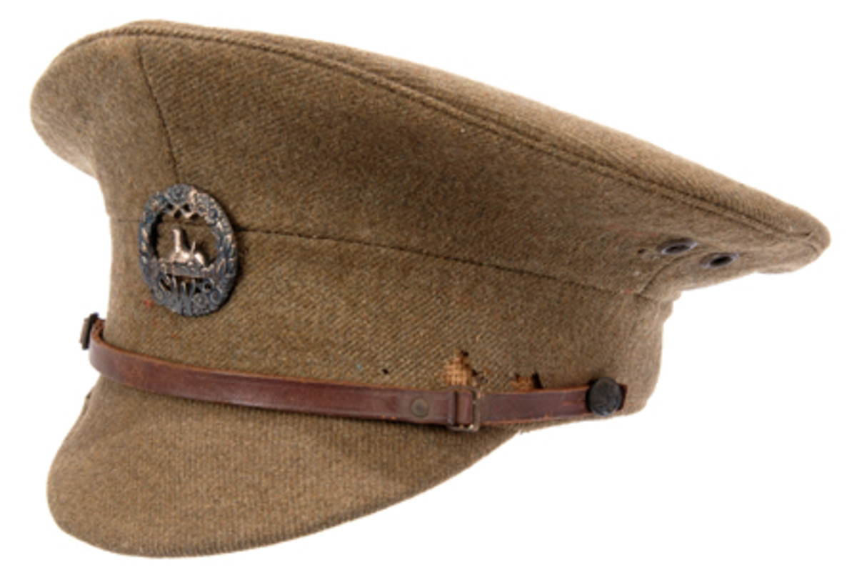 British WWI Enlisted Man's Service Dress Cap of khaki wool serge cap with matching cloth covered leather visor.