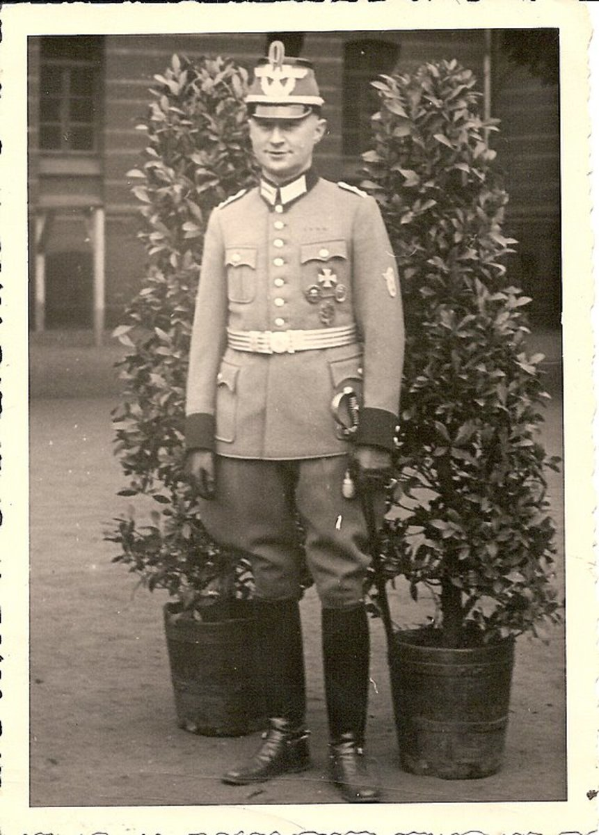 A German Police Officer wearing his walking-out uniform with shako and sword.