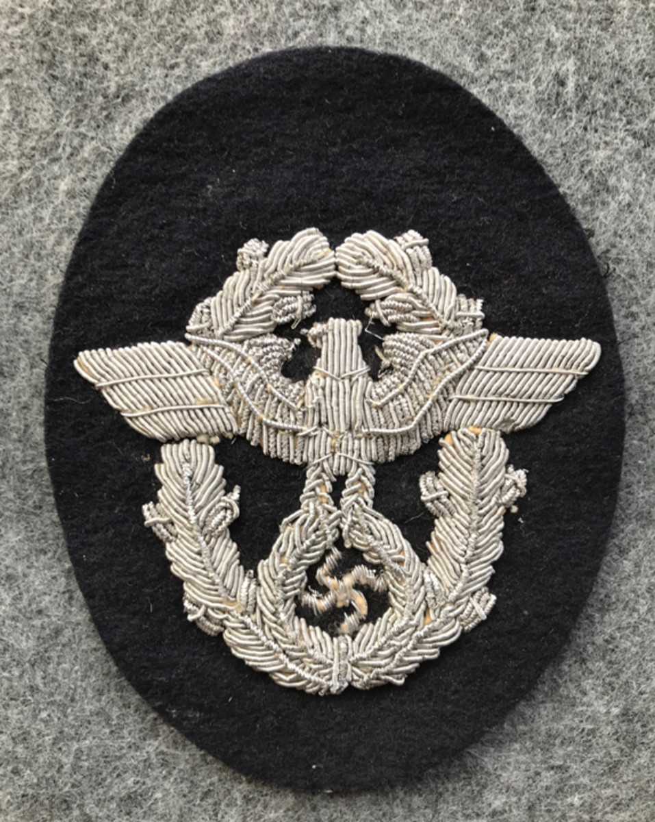 A rare and valuable Panzer Officer Police sleeve eagle. This type of police patch is constructed with the national eagle hand embroidered in bright silver bullion wires on black wool cloth. It would have been worn on a Panzer Wrap Tunic. Because of its rarity, this type of German WWII police patch retails for around $450-$500.