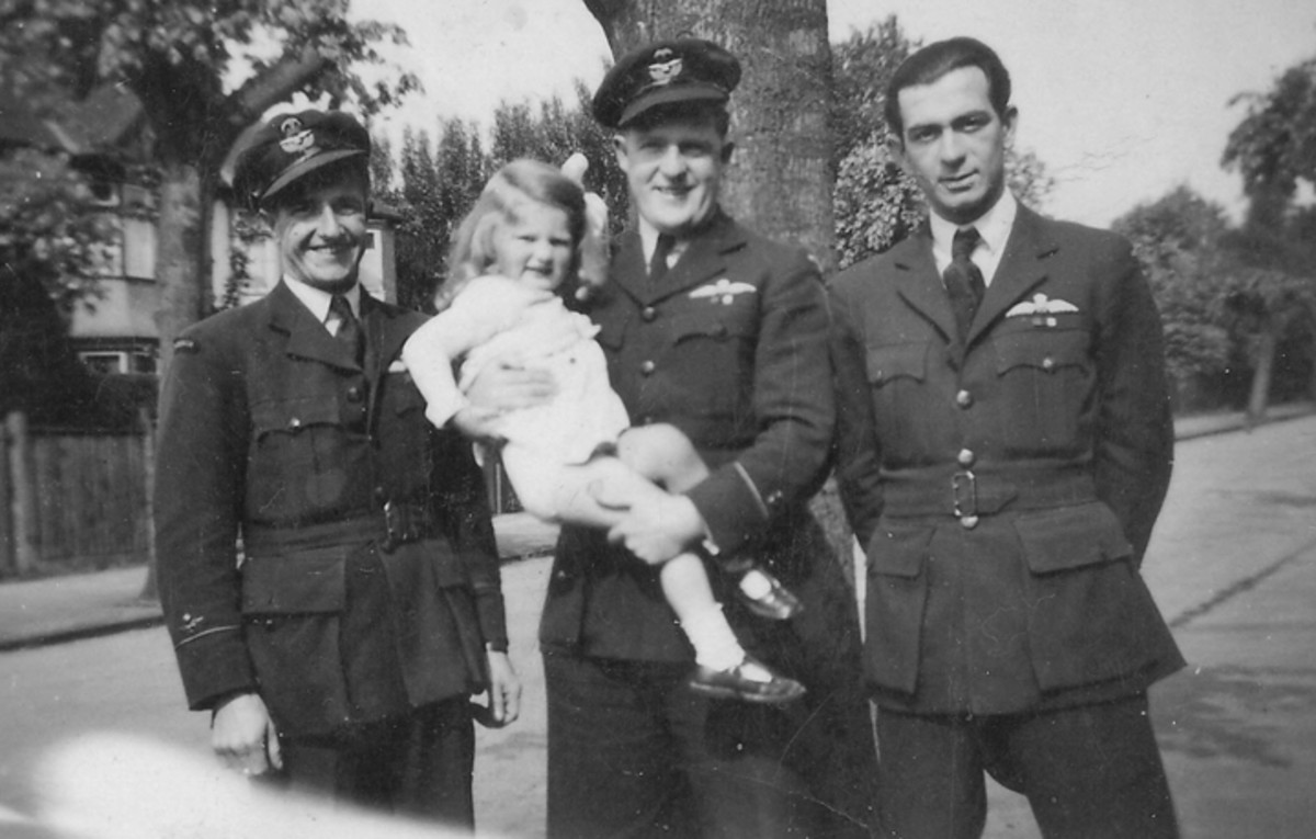 """Walter (""""Mac"""") McBean, the RAF man to whom the uniformed belonged, is on the left in this photo. Terry O'Connor holds a young Jennifer Clark, whose parents invited Dominion airmen to their home."""