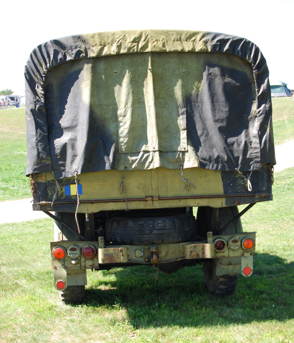 Rear view showing Danish Army marker lights and spare tire.