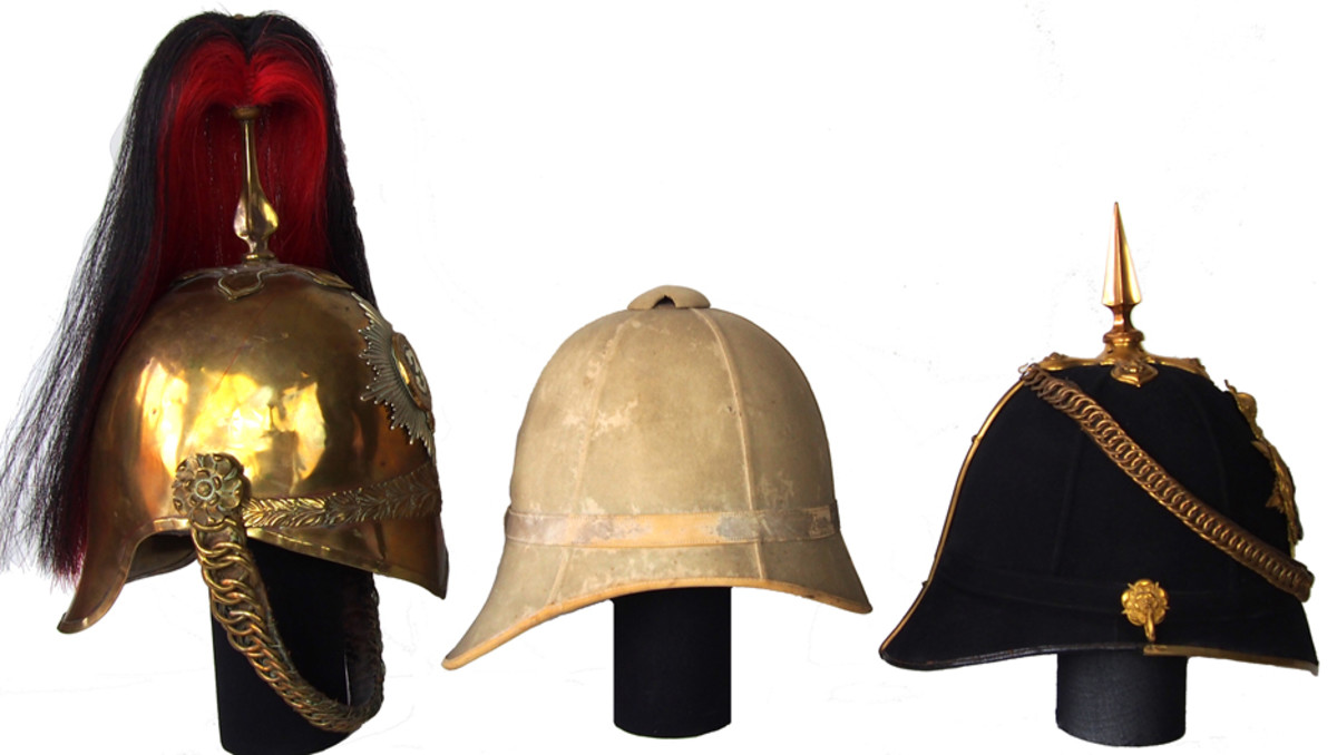 A comparison of the British 1871 Pattern Cavalry Helmet (left) with an early Foreign Service Helmet (center) and an early Home Service Helmet (right) highlighting how these helmets had a similar profile. Note that the British spike is narrow and closely resembles the plume holder of the cavalry helmet.