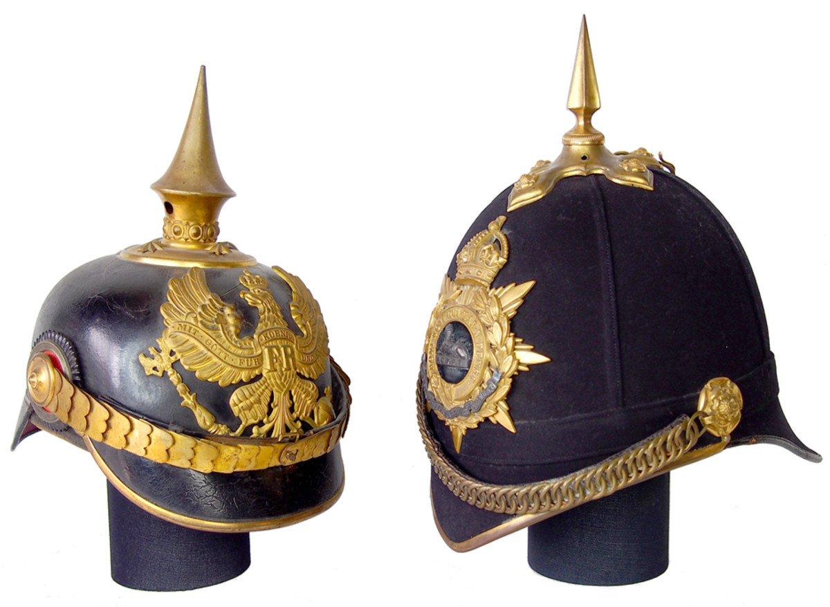 A side-by-side comparison of a Prussian Model 1891 officer's helmet and a British 1878 Pattern Home Service Helmet to Gloucestershire Regiment. The helmets have only a passing resemblance but the materials differ greatly, as does the overall shape.