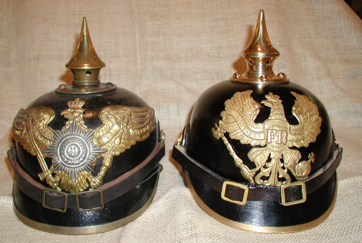 The helmet that appears on the left in this article is the original Model 1895 Prussian spike. The reproduction made by Schipperfabrik is on the right.