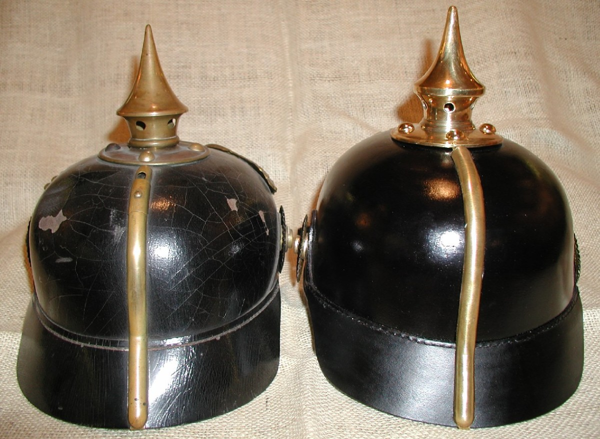 """The rear brass spine (""""Hinterscheine"""") on the repro (right) has two problems: it lacked a vent device and the base was merely bent over the leather neck guard. A little shop work easily corrects the second fault."""