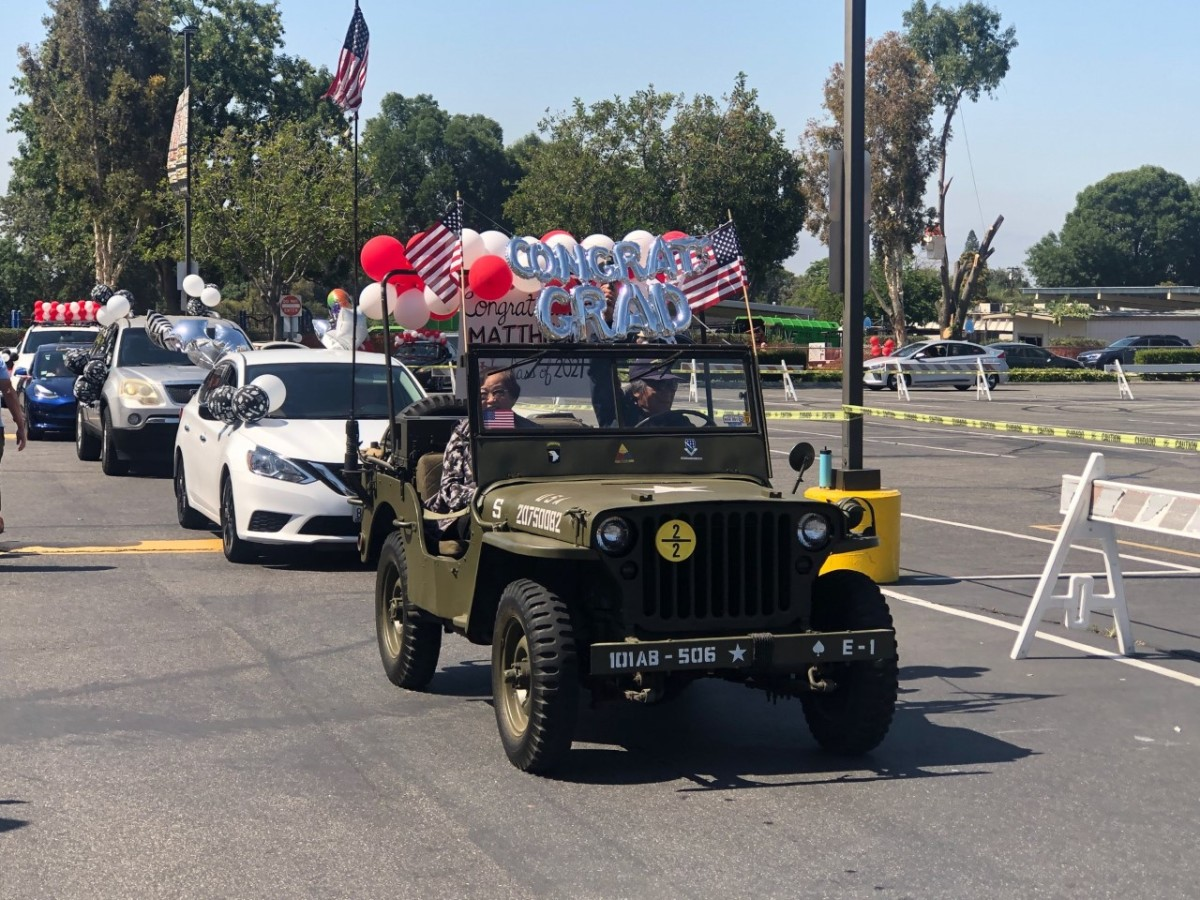 Sandy Luzano driving his 1942 GPW at his grandson's graduation drive by parade, St. Juliana's School on May 28, 2021.