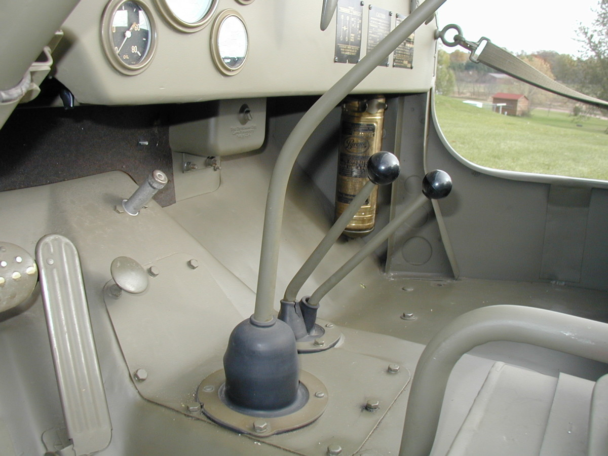 The fire extinguisher is located on right side. Note the rubber shifter boots and filterette location.
