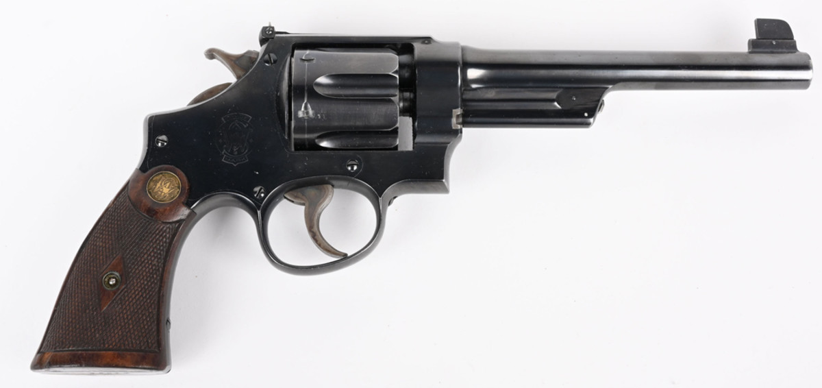 Rare Smith & Wesson big-bore .44 Special triple-lock target model revolver with first swing-out cylinder, made 1911-1912. Sold above high estimate for $6,300