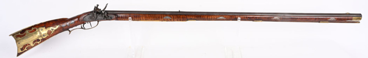 Early, highly ornate .45-caliber flintlock long rifle signed 'P SCHRAK' in period script on the barrel. Very fine condition and a recent discovery from central Ohio. First appearance at auction. Sold for $16,800 against an estimate of $5,000-$8,000
