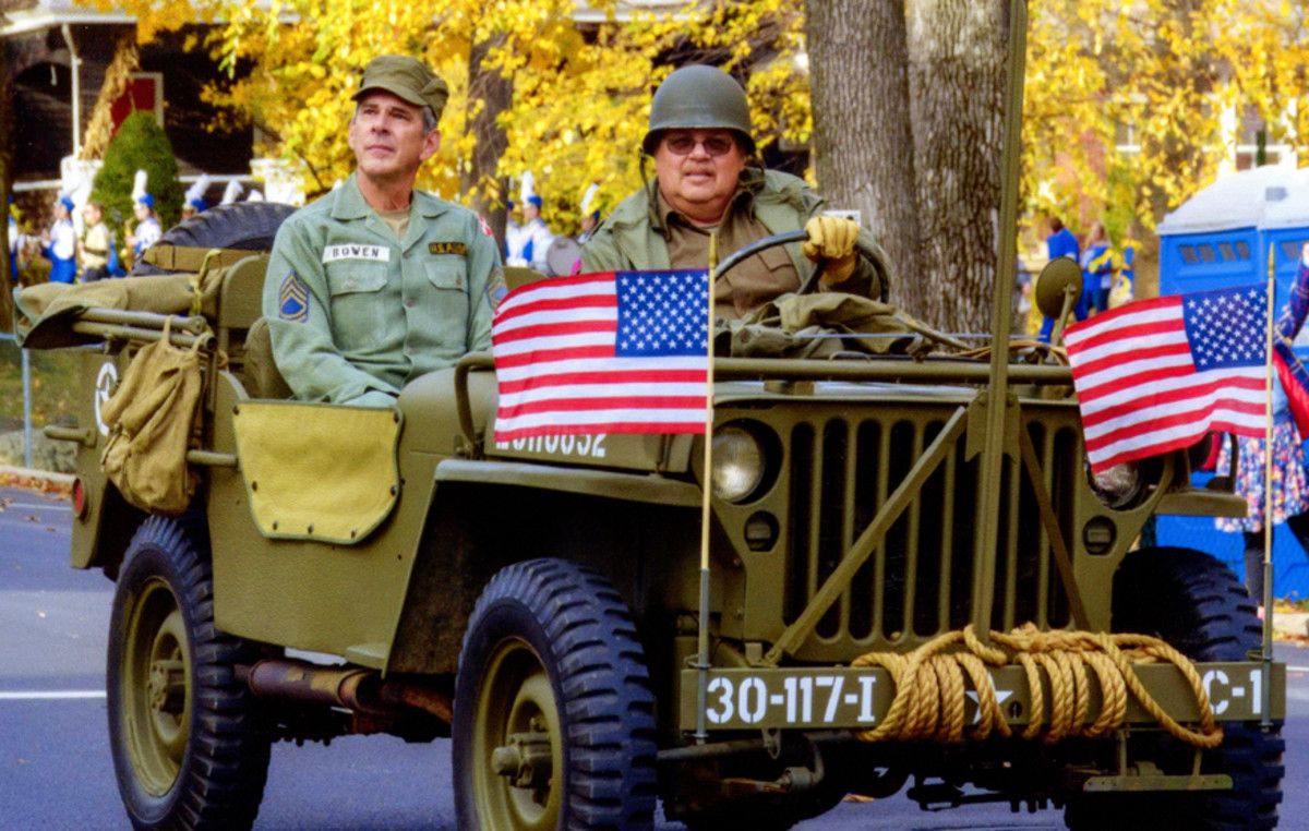 Joe Plechavy driving his cousin Jack in a Veterans Day parade in 2013. Joe's 1942 GPW is a testament to his father's memory and to the service of all veterans.