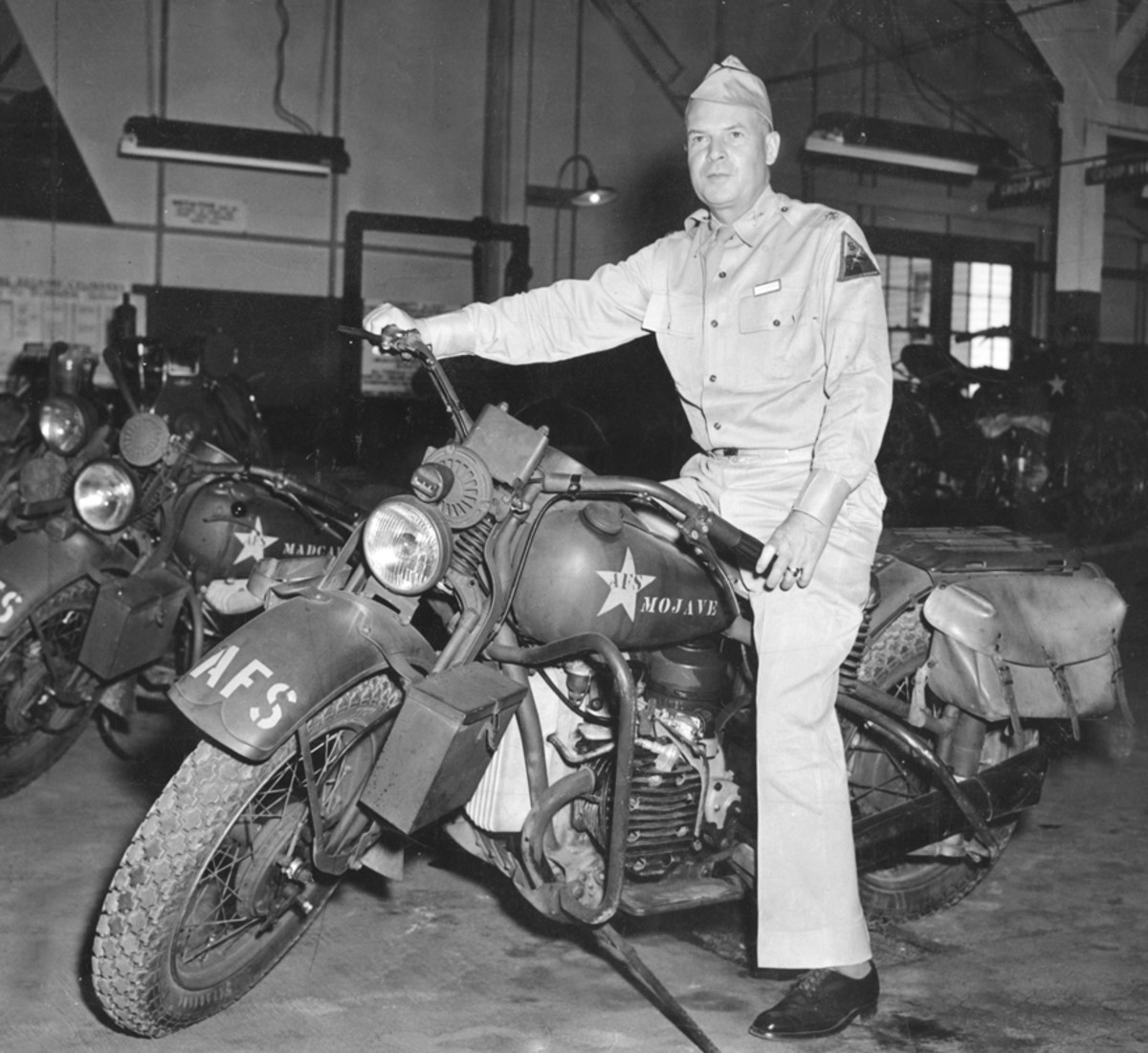Lt. John E. Harley, director of motorcycle training at Fort Knox in 1942, astride a Harley XA. The horizontally opposed engine is visible just forward of his leg.