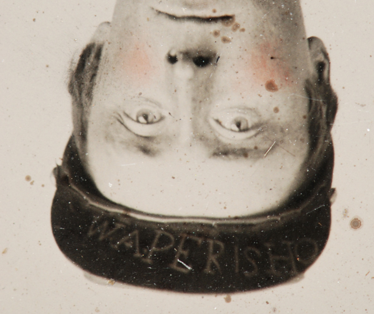"""A quick 180-degree rotation and horizontal flip revealed his identity written on the leather visor: """"W.A.Perisho."""""""