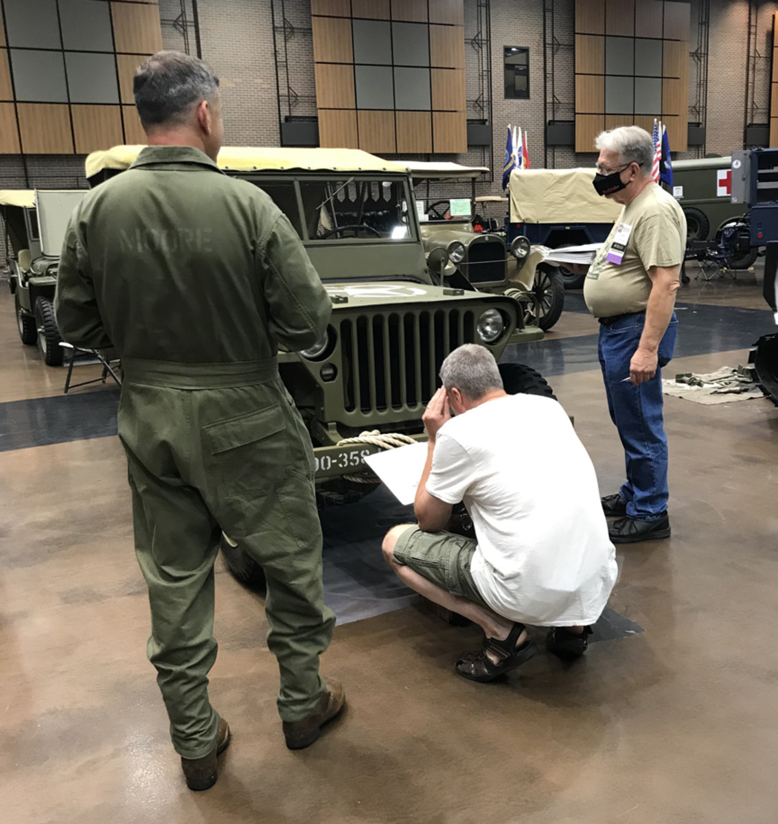 Judges scrutinizing a WWII Jeep at the 2021 MVPA Convention.