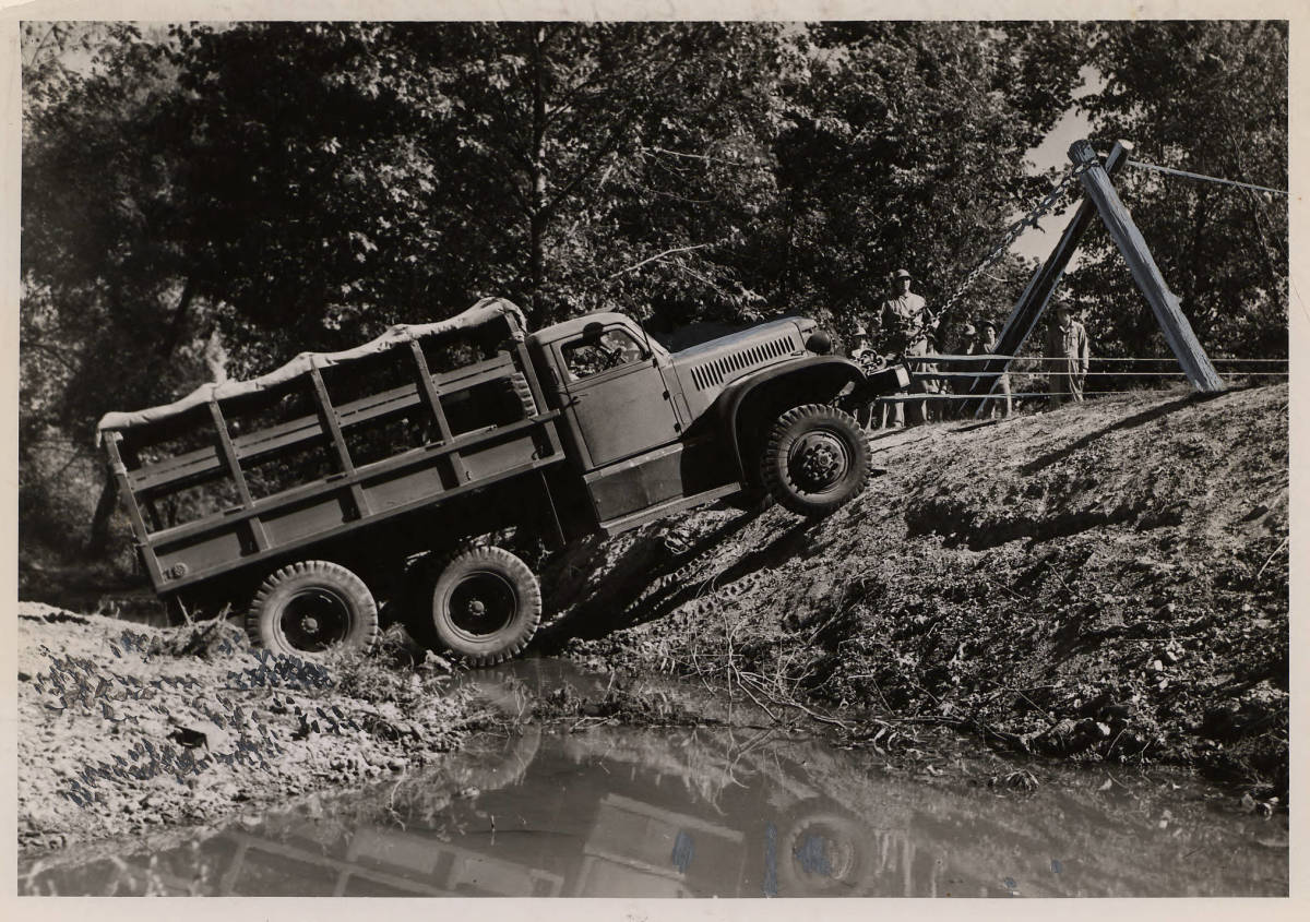 6x6 Diamond T cargo truck using its front-mounted winch to extricate itself during Motor Transport training at Camp Crowder, Missouri.