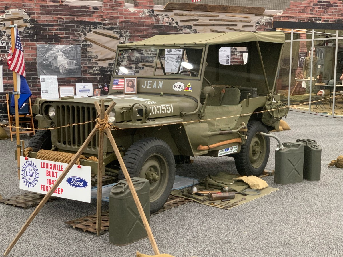 """Mario Maipid sent this photo of his 1943 Ford Model GPW currently on display at the 2021 Kentucky State Fair - Educational Exhibit: """"Kentucky Remembers World War II."""" His GPW and the accompanying displayed items seen in the background are in paying tribute to JEAN LINDOW - HUEY (1927-2021) the young lady photographed on the """"LAST JEEP"""" that rolled off the Louisville Branch on July 1945. Mario named my GPW """"JEAN"""" for this tribute for the duration of the Kentucky State Fair.GPW 98036 (Matching SNs) DoD 2-16-43, Louisville Branch"""