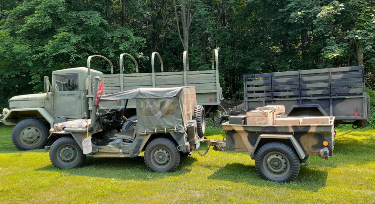 Denis Newman's 1962 Ford M151A2 and matching trailer are restored back to original. The M35A2, though, is an AM General!