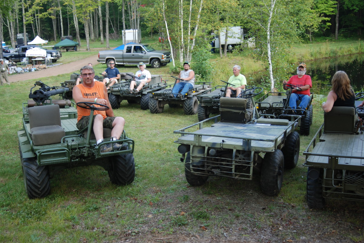 """This year's theme for the Central Military Vehicle Show was the """"Year of the Mule."""" On any of the days of the August event, more than a dozen mules could be found driving or grazing on the expansive, forested show grounds. Brad Holcomb (left) was this year's designated """"Mule Herder."""""""