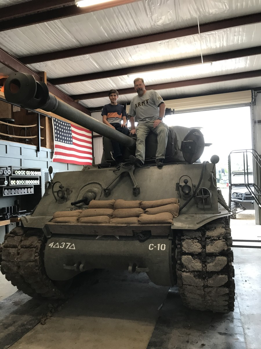"""Here we are just """"hanging out on a fully restored Sherman M4A3A8. The level of restoration and attention to detail was phenomenal. This tank could have just rolled off the assembly line and onto the battlefield."""