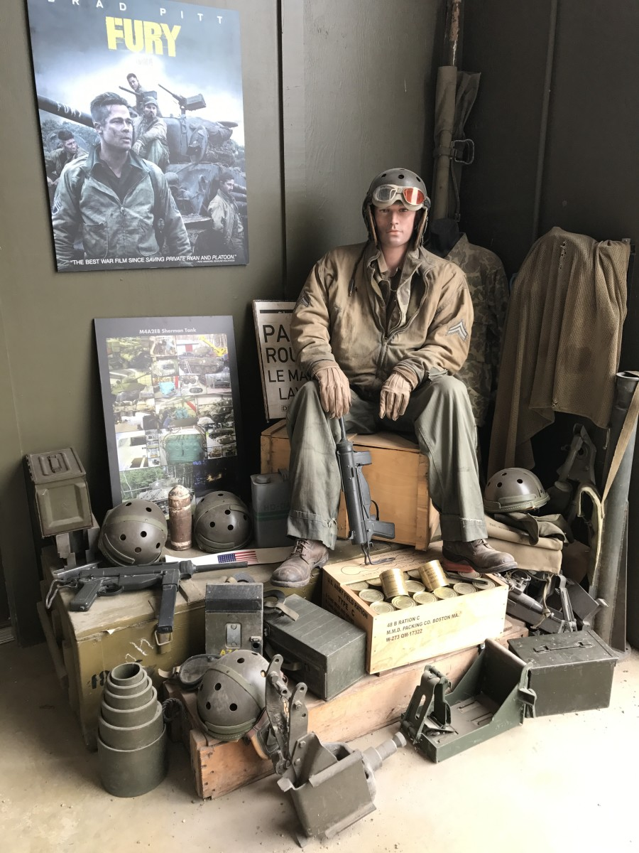 """The """"Tank Barn"""" is filled with displays of vintage WWII tank memorabilia. This uniform was worn by Michael Pena in the movie """"Fury."""""""
