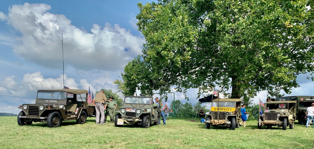 """KILROY Chapter MVPA members Ford vehicles at a recently concluded MV show at the """"HONOR THE FALLEN - LST 325 TOUR"""" - Brandenburg Riverfront Park, Brandenburg, KY, 5 September 2021. L-R: 1967 M151A1 MUTT; 1965 M151A1 MUTT; January 1943 Louisville-built model GPW; and February 1943 Louisville-built Model GPW."""