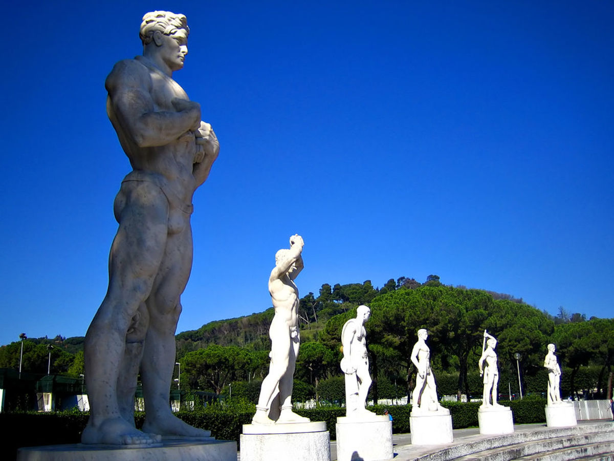 Not toppled.Sixty 4-meter tall, Carrara marble athletic sculptures ring around the stadium. They were produced by 24 artists and sculptors during the Fascist regime